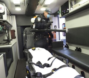 Port Authority Police Officer Shaun Kehoe, disinfectants an ambulance at Hackensack Meridian Health Hackensack University Medical Center. Port Authority PBA paid for the equipment. Friday, Apr. 24, 2020.