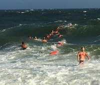 Rescue crew forms human chain to save man from ocean