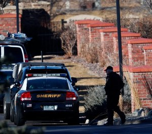 An investigator heads to the scene of a deadly domestic disturbance Sunday, Dec. 31, 2017, in Highlands Ranch, Colo.