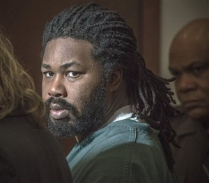In this Nov. 14, 2014 file photo Jesse Matthew Jr., right, looks toward the gallery while appearing in court in Fairfax, Va.