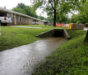 In this May 25, 2015 photo is the box culvert where Claremore Fire Department Capt. Jason Farley was trapped and drowned on Saturday in Tulsa, Okla. (Mike Simons/Tulsa World via AP)