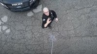 Video: Man uses to drone to deliver doughnuts to cops