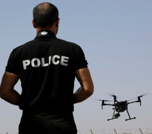 A police officer of SBA controls a drone during a demonstration at the British police station inside the British military base in Dhekelia in southeast of the island of Cyprus, Thursday, Sept. 21, 2017. (AP Photo/Petros Karadjias)