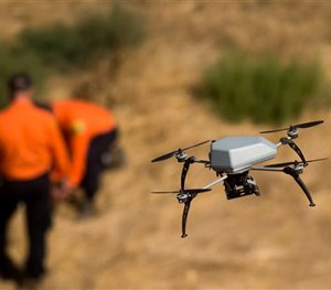 The UAV has been spotted almost every single day, hovering above area shops, local parks, and other places. (AP Image)