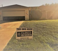 Fla. cops leave 'closed for business' signs in front of raided homes