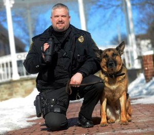 In this Feb. 24, 2015, file photo, Ligonier Township, Pa., Police Department Lt. Eric Eslary poses for a photo with his K-9 partner Blek in Ligonier, Pa. (Evan Sanders/Pittsburgh Tribune-Review via AP, File)