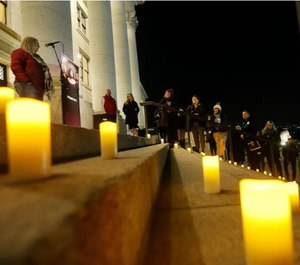 Victims who died from domestic violence are represented by candles during a memorial service in Salt Lake City, Utah on March 7, 2018. Police and advocates are concerned by a spike in domestic violence calls stemming from nationwide COVID-19 lockdowns.