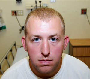 Officer Darren Wilson during his medical examination after he fatally shot Michael Brown, in Ferguson, Mo. (AP Image)