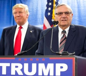 In this Jan. 26, 2016, file photo, then-Republican presidential candidate Donald Trump is joined by Joe Arpaio, the then sheriff of metro Phoenix, during a news conference in Marshalltown, Iowa.