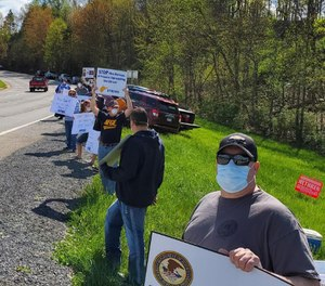 Members of a union representing federal correctional officers gathered Saturday to protest a transfer of out-of-state inmates to facilities in West Virginia.