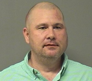 Bentonville Fire Capt. Benjamin Snodgrass is accused of a racist assault on an Asian man earlier this month.