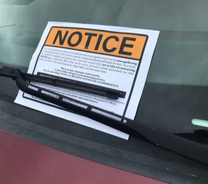 Kentucky troopers placed notices on the vehicles of parishioners attending an in-person Easter service at Maryville Baptist Church. (Photo/TNS)