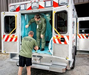 Grady EMS Commander Aaron Jamison (left) and Grady EMS Interim Director Wade Miles prepare for the transport of Dr. Kent Brantly, the first Ebola-infected American aid worker who was brought from Africa to Emory University Hospital in Atlanta, Ga. for treatment. (Image Grady EMS)