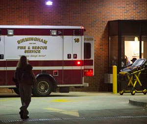 An ambulance sits outside the University of Alabama at Birmingham Hospital emergency room where a patient with possible Ebola symptoms was admitted, Tuesday, Aug. 4, 2015, in Birmingham, Ala. Officials say a quarantine is in place at a Birmingham home over concerns about the possible case of the Ebola virus. Jefferson County Medical Director Edward Khan says the patient recently traveled to a country with active Ebola cases, but he didn't identify the country or name the patient. (AP Photo/Brynn Anderson)