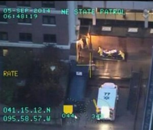 In this frame grab made from video which was released by the Nebraska State Patrol, Dr. Rick Sacra, 51, who was infected with Ebola while serving as a family doctor in Liberia is taken on a gurney by two persons wearing protective gear, as he arrives to the Nebraska Medical Center in Omaha, Neb., Friday Sept. 5, 2014. Sacra, who served with North Carolina-based charity SIM, is the third American aid worker infected by the Ebola virus. (AP Photo/Nebraska State Patrol)