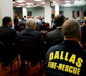 This file photo made Thursday, Dec. 8, 2016, shows the gallery during a Dallas Police & Fire Pension System board of trustees meet in Dallas.