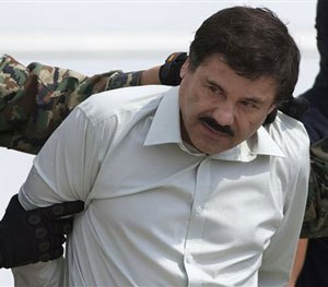 "his Feb. 22, 2014 file photo shows Joaquin ""El Chapo"" Guzman, the head of Mexico's Sinaloa Cartel, being escorted to a helicopter in Mexico City. (AP Image)"