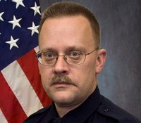 Son arrested after off-duty Minn. cop shot dead