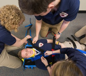 EMS students participate in a training session at Willamette University. The college's student-run Willamette EMS takes real emergency calls from campus at no cost to student patients.