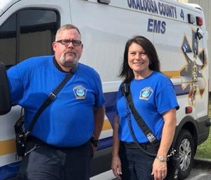 Kris Kempf and Karen Griffin rebuilt a wheelchair ramp for a patient after his wheelchair slid off of it. (Photo/OCEMS)