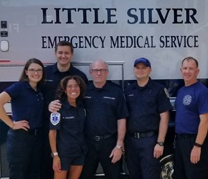 Freehold EMS Squad Chief Jeff Hoffman (fourth from left) stands with a few of the responders who helped save his life. (Photo/EMSCNJ)