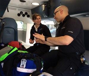 Paramedic/FTO Jacob Polen reviews equipment with new EMT Sarah Drmota.