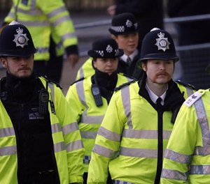 Police officers arrive at the Supreme Court in London, Monday, Dec. 5, 2016.