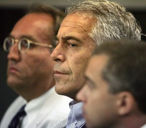 In this July 30, 2008 file photo, Jeffrey Epstein appears in court in West Palm Beach, Fla. Epstein has died by suicide while awaiting trial on sex-trafficking charges, says person briefed on the matter, Saturday, Aug. 10, 2019. (AP Photo/Palm Beach Post, Uma Sanghvi, File)