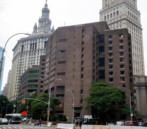 Two correctional officers responsible for guarding Jeffrey Epstein the night he killed himself at the Metropolitan Correctional Center have been charged with falsifying prison records. (Photo/AP)