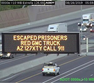 This photo from an Arizona Department of Transportation remote camera shows a digital sign over Interstate 10 in the Phoenix metropolitan area that seeks the public's help in locating escaped murder suspects,Wednesday, Aug. 28, 2019.