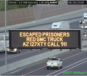 This photo from an Arizona Department of Transportation remote camera shows a digital sign over Interstate 10 in the Phoenix metropolitan area that seeks the public's help in locating escaped murder suspects,Wednesday, Aug. 28, 2019. (Arizona Department of Transportation via AP)