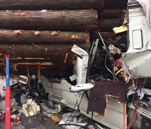 A field amputation was necessary to remove the drive of a semi after a collision with a log hauler on a remote stretch of I-90 in north Idaho.