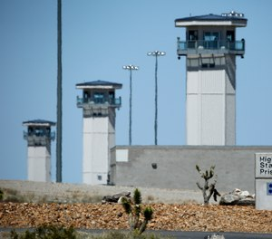 In this April 15, 2015 file photo guard towers are seen at High Desert State Prison in Indian Springs, Nev.