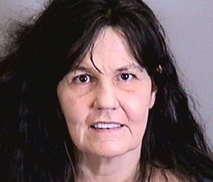 Loriann Goldman, 54, faces corruption by making a threat against a public servant charges. (Photo/Manatee County Jail)