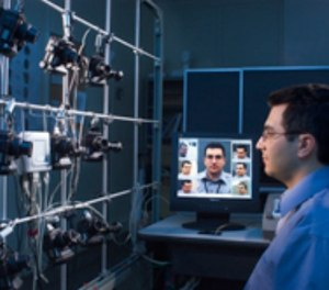 NIST computer scientist Ross Micheals demonstrates a NIST-developed system for studying the performance of facial recognition software programs. (Photo/Robert Rathe)