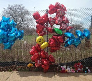 A makeshift memorial sits along a fence Monday, April 17, 2017, near where Robert Godwin Sr., was killed in Cleveland. (AP Photo/Mike Householder)