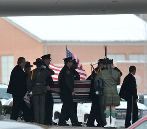 In this Dec. 22, 2010, file photo, law enforcement officers carry the casket of Border Patrol officer and former U.S. Marine Brian Terry out of Greater Grace Temple after his funeral service in Detroit. (John T. Greilick/Detroit News via AP, File)