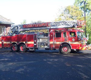 A Christmas Eve house fire in Fayetteville, N.Y., burned for at least 30 minutes after officials say live ammunition and several motorcycles in the garage created a hazard for firefighters.