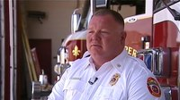 Asst. fire chief helps cop catch robbery suspect