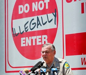 In this Thursday, July 29, 2010 file photo, Maricopa County Sheriff Joe Arpaio speaks in Phoenix announcing his crime suppression sweeps. (AP Photo/Matt York, File)