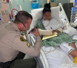 In this photo shared September 19, 2020, an LA County deputy, who has only been identified as a 31-year-old mother, takes a phone call from President Trump in her hospital bed. (Photo/Los Angeles County Sheriff's Department)
