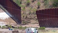 Storms knock down US-Mexico fence in Ariz.