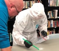 Fentanyl response training for authorized responders includes proper donning and doffing of protective equipment in addition to safe evidence collection practical exercises. (Photo/KDOC)