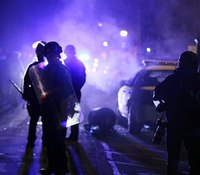 Officials: US report finds racial bias in Ferguson police