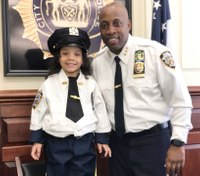 Girl who survived father's suicide is NYPD officer for a day