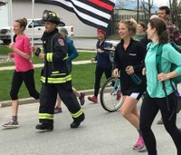 Firefighter breaks world record by running 100 miles in full gear
