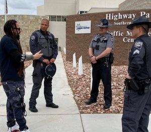 Five Finger Death Punch guitarist Zoltan Bathory (left) visited Nevada Highway Patrol troopers to show support after the death of Trooper Sgt. Ben Jenkins