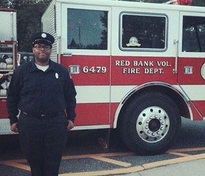 Firefighter-EMT Lt. Andrew Hughes-Hill, 26, was found stabbed after someone called 911 to report the incident.