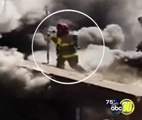 Video: Firefighter falls through roof; critically burned