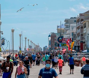 The Ocean City, Maryland, boardwalk filled up quickly in May 2020 after the town dropped many of its COVID-19-related restrictions. The state now has a mask mandate and doesn't plan to lift it soon.